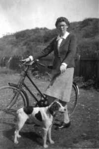 Rene on bicycle with Mr A's dog Bill